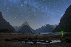Milford sound at night with startrail Stock Image
