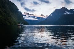 An over-night cruise ship in Harrison Cove at Milford Sound. Milford Sound over night cruise stops in beautiful Harrison Cove for sunset. Milford Sound is a Stock Photography