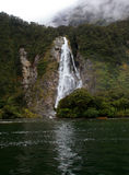 Milford Sound waterfall Stock Photo