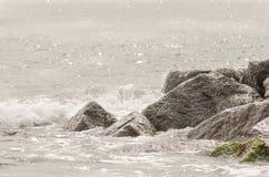 Milford waves crashing. Waves crash onto rocks at milford on sea, hampshire Stock Image