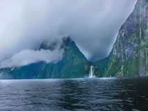 Milfordsound. Many water falls from the top of the mountain to the Tasman sea stock image