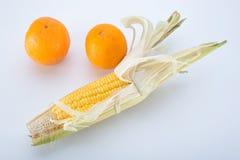 Milho doce com laranja Foto de Stock Royalty Free