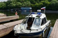 Milicyjna łódź przy dokiem Zdjęcia Stock