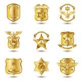 Milicyjne odznaki Złociste Zdjęcie Royalty Free