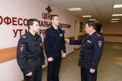 Milicyjnego Colonel czeki w postaci pracowników Obrazy Royalty Free