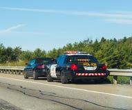 Milicyjny ciągnięcie nad samochodami w Kanada Fotografia Royalty Free