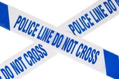 Milicyjny miejsce przestępstwa taśmy krzyż i biel kopii przestrzeń zdjęcie stock