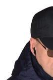 Milicyjny pracownika ochrony personelu policjant potajemnie słucha na specop pola sytuaci, odosobnione tajny agent tajne operacje Zdjęcia Stock