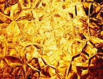 Milieux en cristal colorés d'or du feu de soulagement Images libres de droits