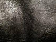 Milieux en cuir noirs de texture, le modèle en cuir noir, milieux abstraits Photographie stock