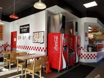 Inside Five Guys Burger. Mililani, Hawaii - April 23, 2017: Inside Five Guys Burger. Fast-food chain with made-to-order burgers, fries & hot dogs, plus free Royalty Free Stock Photo