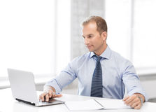 Miling businessman working in office Stock Images