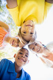 Miling children forming a huddle in circle Stock Image