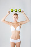 Miling girl with green apple Royalty Free Stock Photo