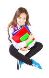 Miling girl sitting with backpack Royalty Free Stock Photo