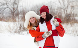Miling girls in winter Royalty Free Stock Image