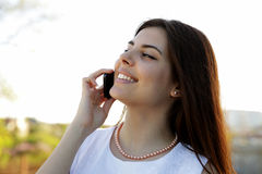 Miling woman speaking on the phone Stock Photography