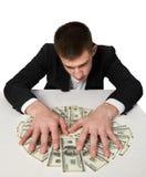 Milionario di ricchezza dei dollari dei soldi Immagini Stock