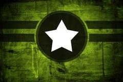Militär arméstjärna över grungebakgrund Arkivfoto
