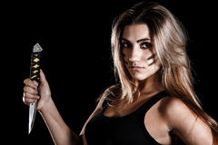 Militär kvinna med en kniv royaltyfri foto