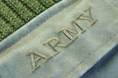 Militäruniform-Strickjacke mit Zeichen-Armee auf der Tasche Stockbilder