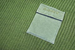 Militäruniform-Strickjacke mit Zeichen-Armee auf der Tasche Lizenzfreie Stockbilder