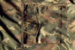 Militäruniformmuster mit Tasche mit Unschärfeeffekt Stockfotos