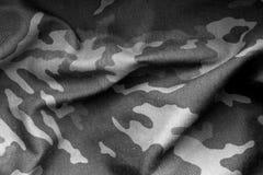 Militäruniformmuster mit Unschärfeeffekt in Schwarzweiss Lizenzfreies Stockfoto