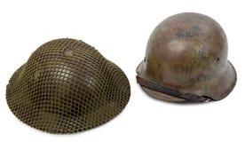 Milit?rsturzhelme des deutschen und britischen Zweiten Weltkrieges, Kampf von Normandie 1944 stockbild