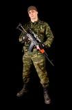 Militair in eenvormig met wapen Stock Afbeelding