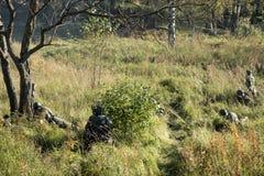 militair in het bos Stock Afbeelding