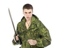 Militaire avec le couteau Photo stock