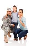 Militaire et famille Photographie stock