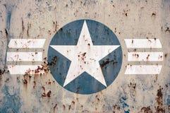 Militaire ster op geslagen metaal Stock Foto