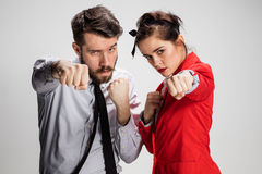The militant business man and woman Stock Photo
