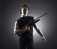 Militant young man with a gun. Royalty Free Stock Photo