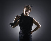 Militant young man with a gun. Stock Photo