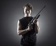 Militant young man with a gun. Stock Photography