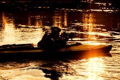 Militants in army kayak Royalty Free Stock Photo