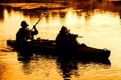 Militants in army kayak Stock Images
