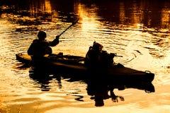 Militants in army kayak Stock Photo