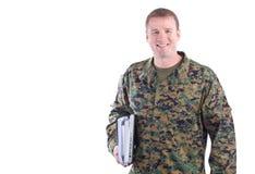 Militar con los libros de escuela Foto de archivo libre de regalías
