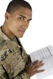 Militar del afroamericano con el libro de texto Foto de archivo libre de regalías