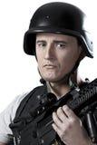 Militares armados en barril protector con un arma Fotografía de archivo libre de regalías