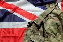 Militares y bandera de unión BRITÁNICOS Imagenes de archivo