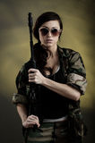 Militarized Young Woman WIth Assault Rifle Royalty Free Stock Image