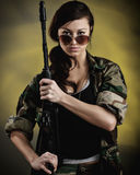 Militarized Young Woman WIth Assault Rifle Stock Image