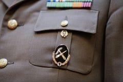 Militarna insygnia na wojskowym uniformu Obraz Stock