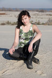 Military. The young woman poses on the beach cold summer day Royalty Free Stock Photography