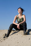 Military. The young woman poses on the beach cold summer day Royalty Free Stock Image